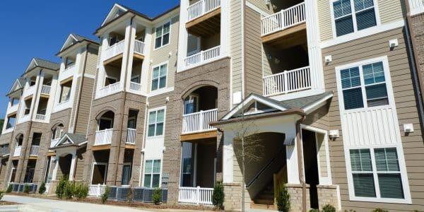 Apartment-Building-Beige-Siding-White-Trim-Brick-copy1